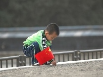 Little boy with Chinese flag